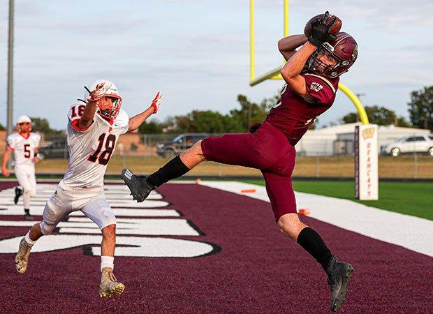 Receiver Reid Thompson of Whitesboro (Texas) hauls in a touchdown against Pilot Point.