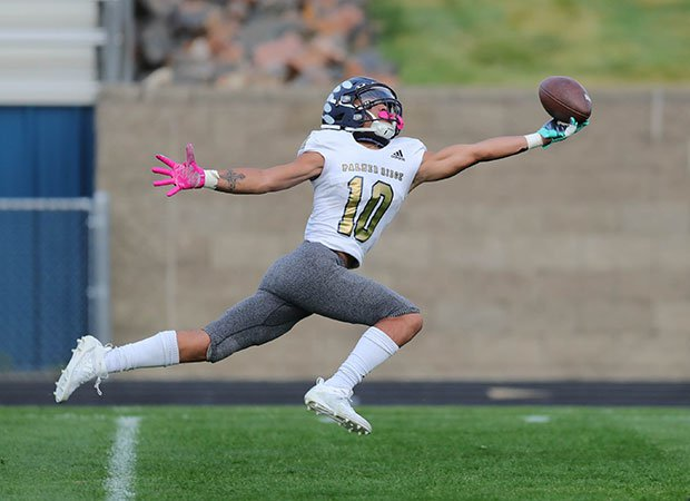 Receiver Marcellus Reed of Palmer Ridge  (Colo.) stretches for a one-handed reception against Golden.