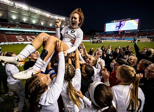 The Olympus (Utah) soccer team raises midfielder Emma Neff aloft after scoring the game-winning, overtime goal in the UHSAA 5A championship game at Rio Tinto Stadium.