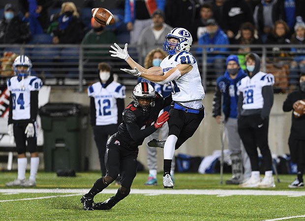 Receiver JD Serwatka of Brunswick (Ohio) makes a leaping catch while defended by McKinley cornerback Caleb Ruffin in a OHSAA D1 Regional Quarterfinal playoff game.