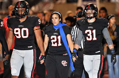 Jacob Logan's sister, Jordan, wore his jersey and represented him during the coin toss before the game.