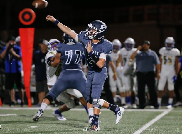 Rattler threw for three touchdowns, ran for two more and caught a scoring pass in Pinnacle's win.