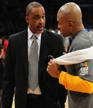 Phil Handy swaps notes with then Lakers guard Derek Fisher.