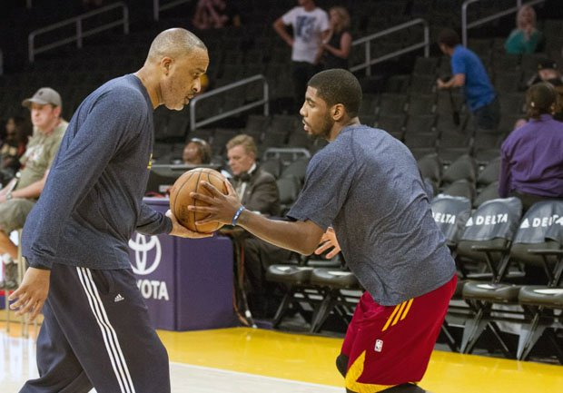 Phil Handy (left) works with Cavaliers point guard Kyrie Irving.
