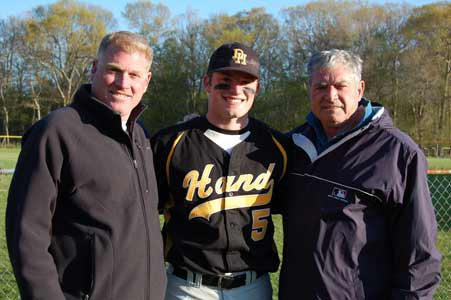 "Nick shares a moment with father Matt and grandfather Len ""Boots"" Merullo."