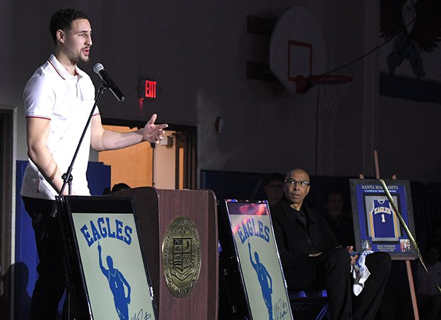 Klay Thompson is honored Friday at Santa Margarita. Thompson's father Mychal (right) – who spent over a decade in the NBA – looks on.