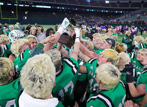 Southlake Carroll players celebrate their 6A Division 1 semifinal won over Duncanville on Saturday. The victory sets up a championship game with Austin Westlake and a battle between father and son head coaches.