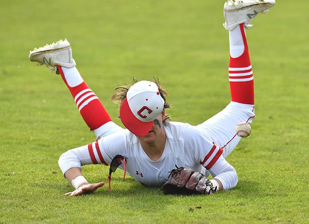 A Fort Worth Christian (Texas) outfielder makes a diving attempt against Bay Area Christian in the Texas Private School Classic.
