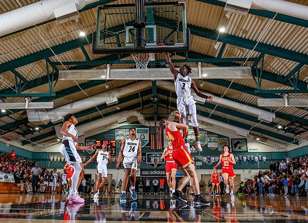 Xavion Brown of Sheldon (Calif.) skies over a Jesuit defender for a dunk.