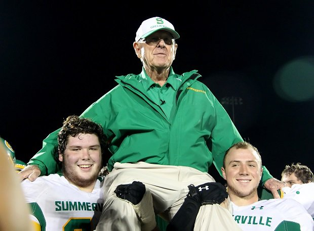 John McKissick is carried off the field by players after winning his 600th game in 2012. The winningest all-time football coach at any level died Thursday at 93.