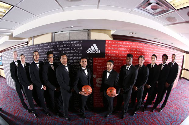 Allocco's West team posing before a formal dinner the night before the big game.