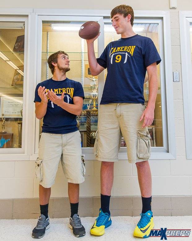 Six-foot-11 quarterback Logan Routt towers over one of his receivers - 5-foot-5 Dalton Wood.