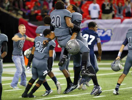 Norcross players celebrate on the field following their victory in the Georgia Class AAAAAA championship game on Saturday night.