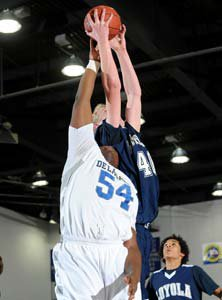 Thomas Welsh (right) goes up for one of his 13 rebounds in Thursday's win over De La Salle (Chicago).