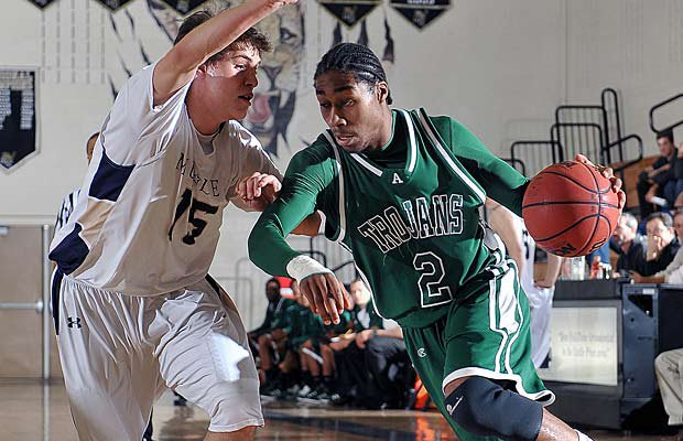 Carlton Hurst, who averaged 23 points per game last season, looks to lead Aurora Central to a state title.