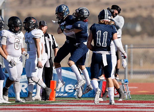Corner Canyon players celebrate one of their touchdowns.