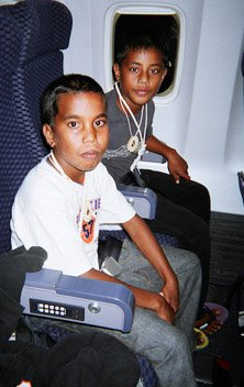 David and Alino on their flight from the Marshall Islands six years ago.
