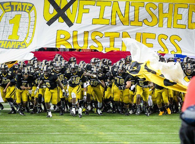 Colquitt County takes the field before the 2014 Georgia 6A title game.