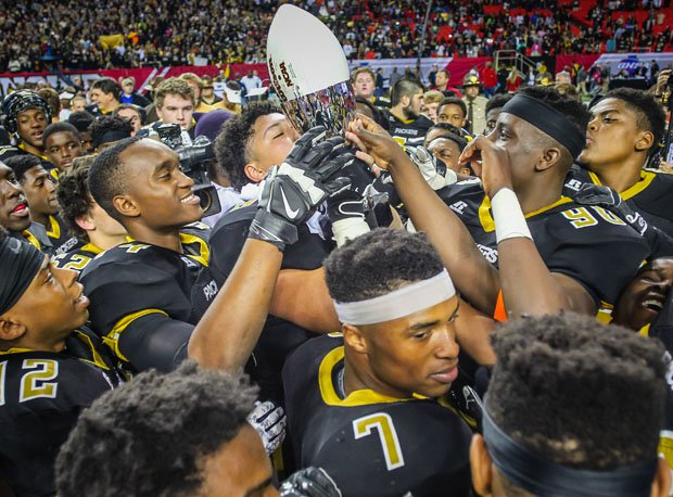 Colquitt County players celebrate after winning the 2014 Georgia 6A state title.