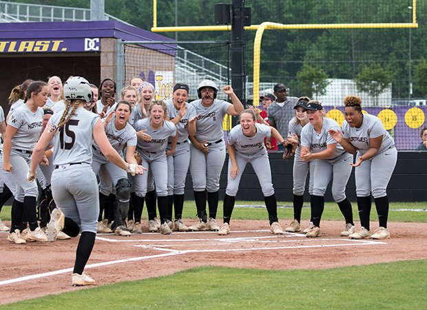 Northwest Rankin (Miss.) players celebrate a home run against Desoto Central during a game in the MHSAA 6A Final Four.
