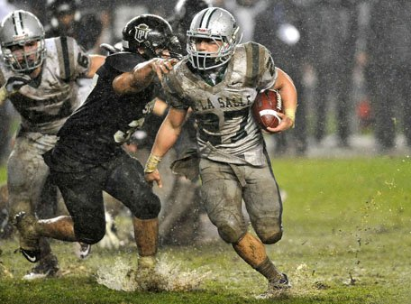Lucas Dunne didn't let the conditions slow him down rushing for 240 yards and four touchdowns.