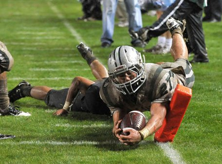Dunne dives inside the pylon for one of his four touchdowns.
