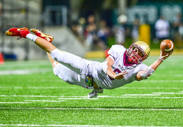 Cypress Woods (Texas) quarterback Bryson Powers dives while attempting a 2-point conversion pass against Cypress Falls.