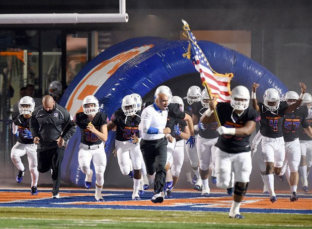 Bishop Gorman enters the field in 2015 against Don Bosco Prep.