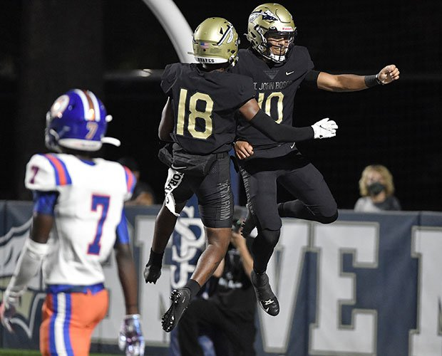 Bosco quarterback Pierce Clarkson (right) celebrates one of his two rushing touchdowns with teammate Jahlil McClain.