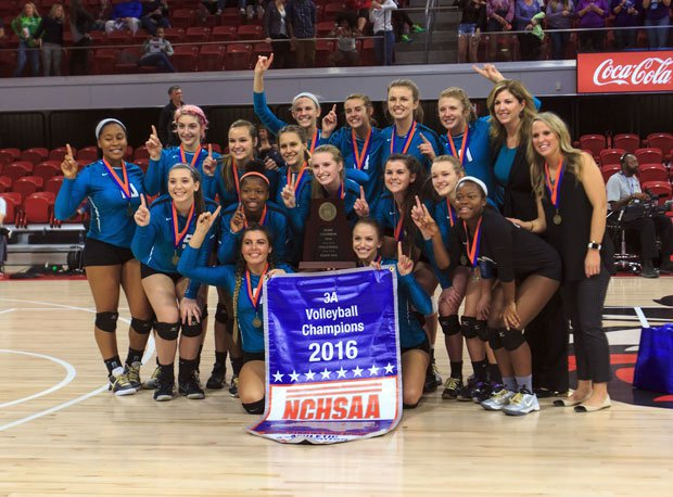 Small school Coach of the Year Michelle Phillips and her Cox Mill team after winning the North Carolina 3A volleyball title.