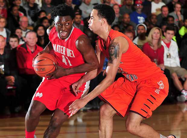 Leading scorer Stanley Johnson drives the lane Saturday at the Nike Extravaganza against Whitney Young.