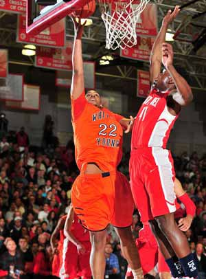 Jahlil Okafor goes to the hoop while Mater Dei'sStanley Johnson crashes in for a block.