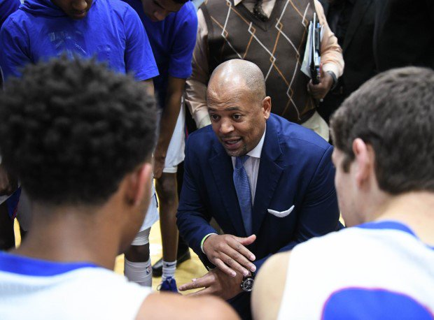 Mike Jones coaches up his DeMatha squad during a timeout.