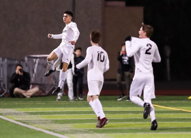 Kalani Kossa-Rienzi celebrates a score in the North Coast Section Division 1 championship game against De La Salle.