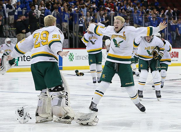 James Betz (right) of Morris Knolls (N.J.) celebrates with goalie Elliot Marken after defeating Monclair in overtime to win the NJSIAA Group A state championship at the Prudential Center.