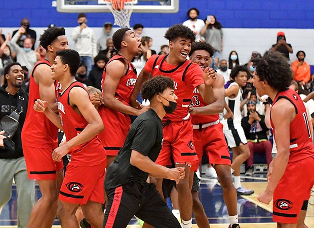 Centennial players celebrate their victory over host Sierra Canyon on Friday night in the Southern Section Open Division title game.