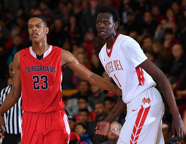 Crossroads' Shareef O'Neil (left) squares off with Mater Dei's Bol Bol on Friday night.