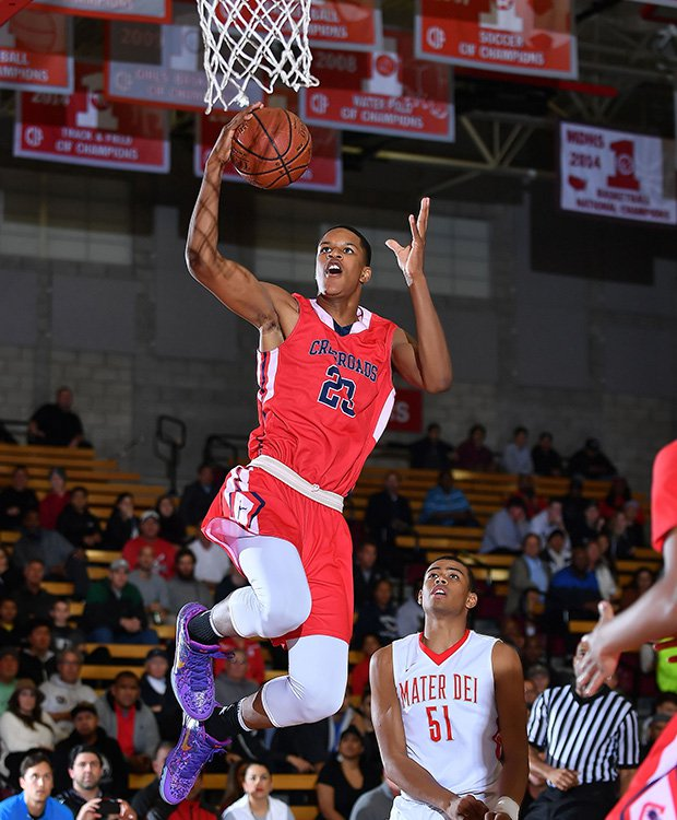 Crossroads' Shareef O'Neal drives for a layup.