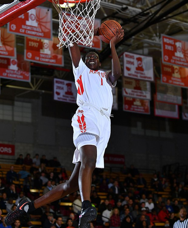 Mater Dei's Bol Bol soars in for a dunk.