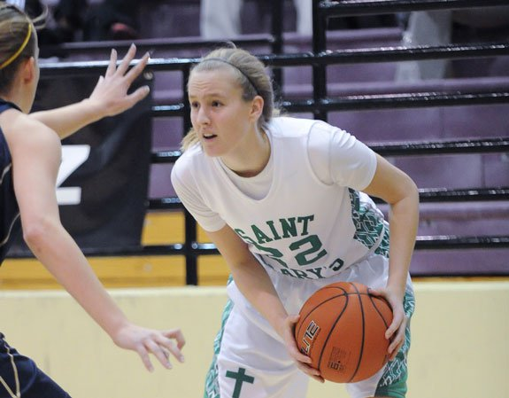 Coach's daughter Courtney Ekmark and the St. Mary's girls basketball team are on the verge of a national title. Teamwork and brutal practices have laid the foundation for Arizona's most dominant team.