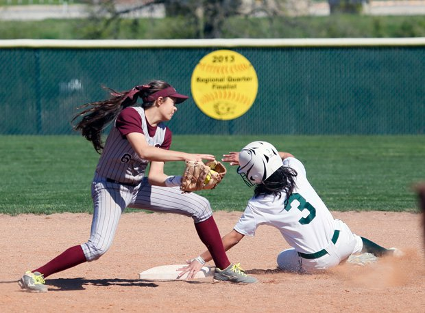 Incarnate Word's Sofia Herrera slides in safe for the state champion Shamrocks.