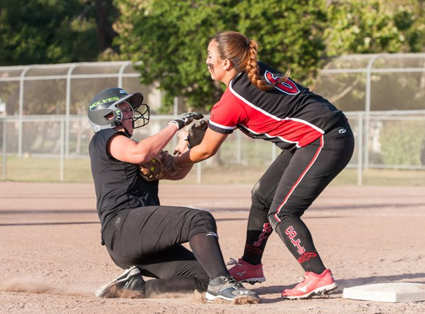 Deanne Garza (right) and the James Logan softball team have moved into the Xcellent 25 as they battle in the playoffs.