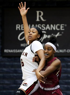 Newman's 5-10 Arie Searcy (right) outrebounded Salesian's 6-5 Angel Jackson in Saturday's NCS championship game.