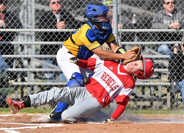 Casey Payne of Sam Rayburn (Ivanhoe, Texas) is tagged out  at home plate by a Bland catcher during a game in the Blue Ridge Tournament in Texas.