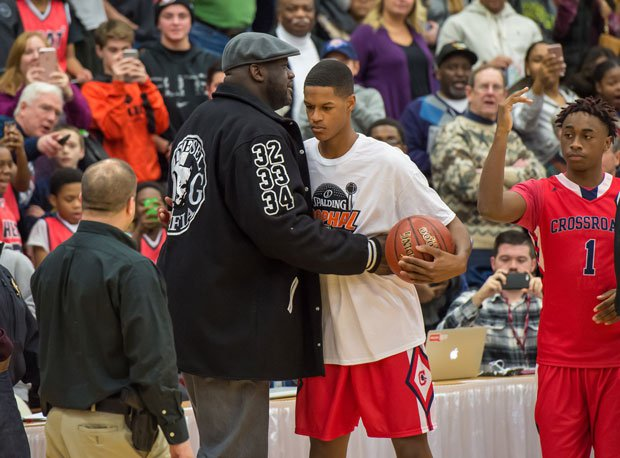 Shareef embraces his famous father at the Spalding Hoophall Classic in January.