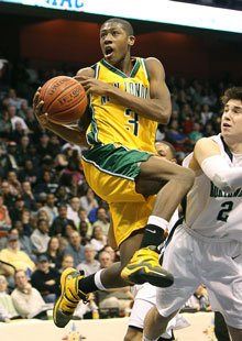 Kris Dunn is returning to the school he led to a state title in March.