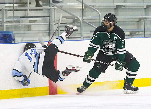 Dante Puleo of Ramapo (N.J.) lays  a hit on Mahwah's Nikolas Uva in the first round of the Bergen County Tournament.