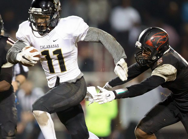 Calabasas receiver and defensive back Darnay Holmes (11) is one of nation's top all-around athletes.
