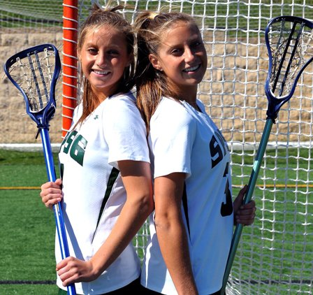 It might require a double-take to determine which of the Boyd twins are which. Kelly (left) and Brooke, both headed to the University of Virginia, are leading the St. Paul's Girls squad this season with twin connections.