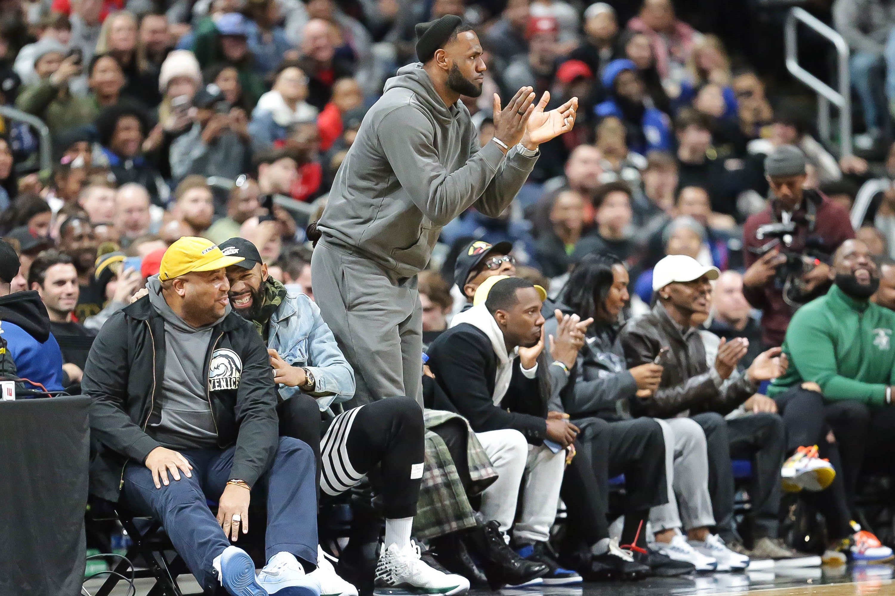 LeBron James, our retroactive 2003 Male High School Athlete of the Year, cheers on his son at a game in December.